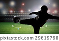 silhouette soccer player kicking the ball 29619798