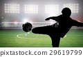 silhouette soccer player kicking the ball 29619799