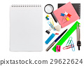 Notebook and stationery items beside on white 29622624