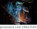 Team workers are welding part in factory 29623595