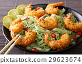 Shrimp in breadcrumbs with green pasta 29623674