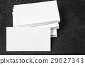 Blank business cards on black leather background 29627343