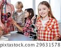 Diligent optimistic children conducting a research 29631578