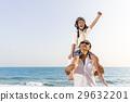 Boy enjoy playing aviator with father on beach 29632201