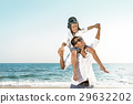 Boy enjoy playing aviator with father on beach 29632202