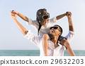 Boy enjoy playing aviator with father on beach 29632203