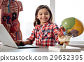 Bright student using technology for studying 29632395