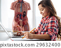 Creative clever student writing a research paper 29632400