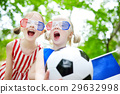 Two adorable little soccer fans cheering 29632998