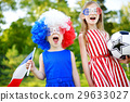 Two funny little sisters supporting and cheering their national football team 29633027