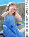 Adorable little girl pretending to be looking through binoculars 29634741