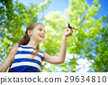 Adorable little girl playing with small toy airplane outdoors 29634810