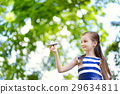 Adorable little girl playing with small toy airplane outdoors 29634811