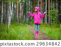 Adorable little girl playing happily in the rain 29634842