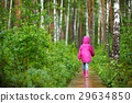 Adorable little girl playing happily in the rain 29634850