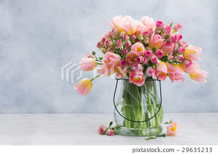 Pink and yellow tulips and roses 29635233