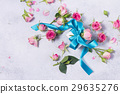 Gift box with satin bow and flowers 29635276