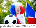 Funny little girl supporting and cheering her national football team 29635775