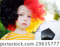 Sad little german child crying over her national football team's loss 29635777