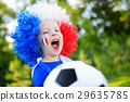 Funny little girl supporting and cheering her national football team 29635785