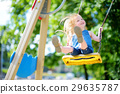 Cute little girl having fun on a playground 29635787