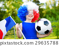 Funny little girl supporting and cheering her national football team 29635788