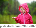 Adorable little girl playing happily in the rain 29635807