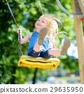 Cute little girl having fun on a playground 29635950