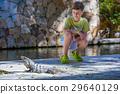 Boy seating on background with iguana 29640129