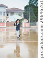 Happy asian boy holding colorful umbrella 29646261