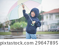 Happy asian boy holding colorful umbrella playing 29647895