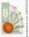 Leather baseball ball and us dollar banknotes. 29650033