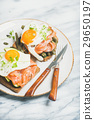 Healthy breakfast sandwiches in plate over marble 29650197