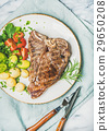 Meat dinner plate with cooked beef t-bone steak 29650208