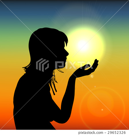 Silhouette woman on sunset holding sun in hand on 29652326