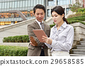 Male and female office workers 29658585