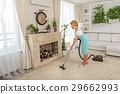 Careful woman cleaning light room 29662993