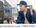 Attentive repairman checking appliance 29663061