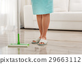 Female person cleaning flooring in house 29663112