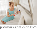 Merry woman holding detersive spray 29663125