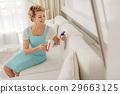 Merry woman holding detersive spray 29663125