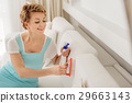 Attentive smiling housewife doing cleanser 29663143