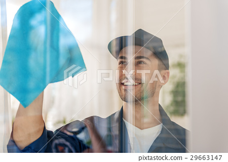 Happy smiling male person behind glass 29663147