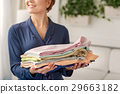 Happy smiling woman holding apparels 29663182