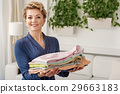 Cheerful lady keeping colored wearing 29663183