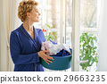 Merry smiling female person with chore of clothes 29663235