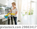 Busy woman cleaning light house 29663417