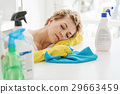 Exhausted female person at kitchen 29663459