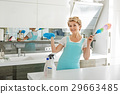 Cheerful smiling female person in cook room 29663485