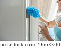 Careful woman cleaning surface in kitchen 29663500